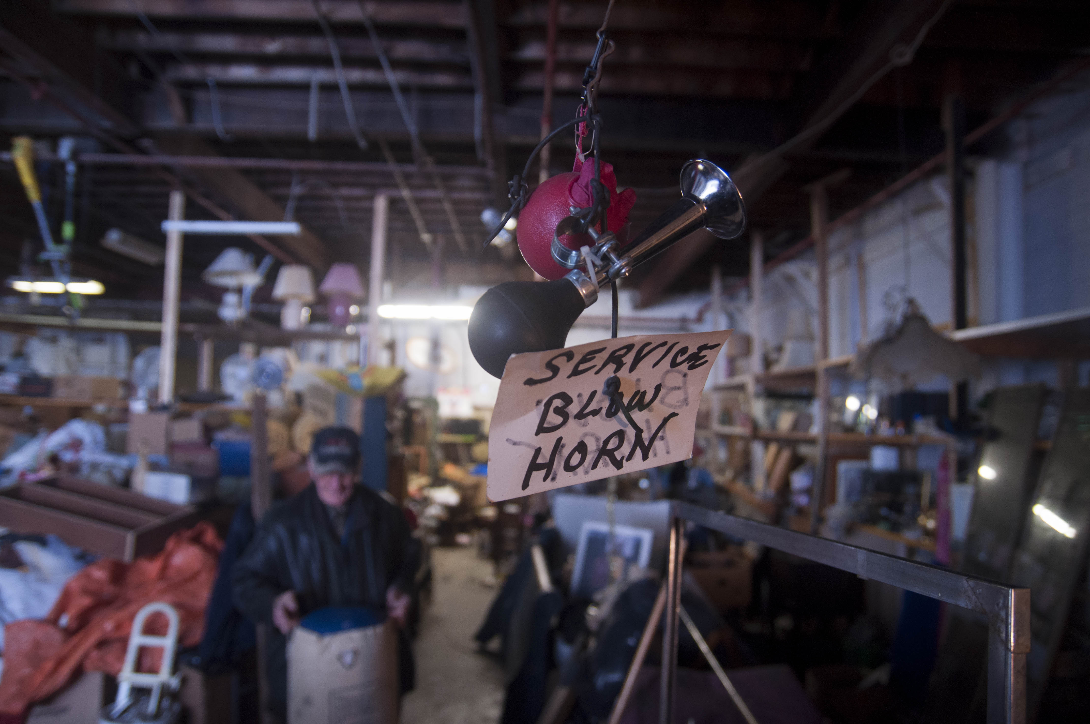 Ken Wilson is often busy in his cavernous store, so this horn.